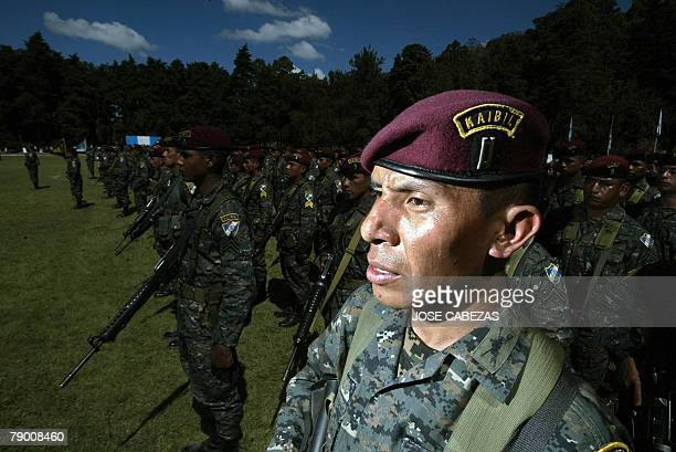 Guatemalan soldiers of the Kaibiles Unit listen the speech of the new president and Chief commander of the army Alvaro Colom during a ceremony at the...