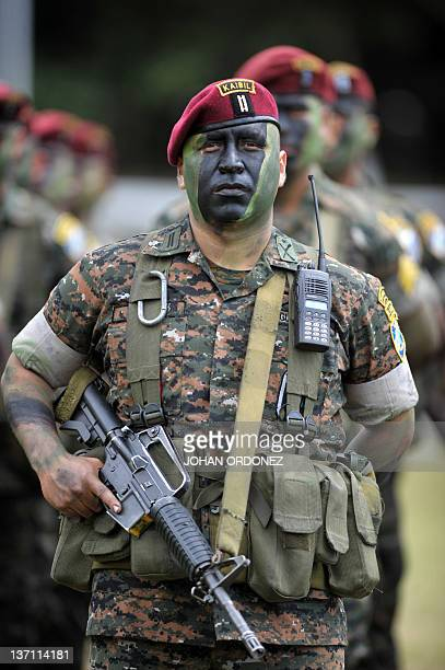 Guatemalan soldiers of the Kaibiles Unit listen to the speech by Guatemala's President Otto Perez Molina during a military parade at the Mariscal...