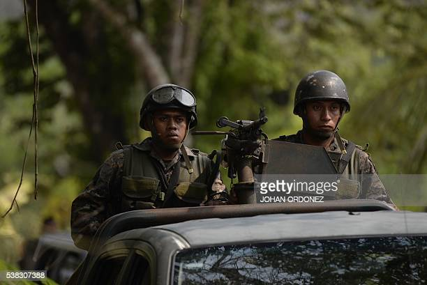 Guatemalan soldiers seen in a burned area in the Maya Biosphere Reserve in San Andres municipality Peten department 500 km north of Guatemala City on...