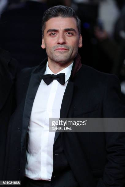 GuatemalanAmerican actor and musician Oscar Isaac poses on the red carpet for the European Premiere of Star Wars The Last Jedi at the Royal Albert...