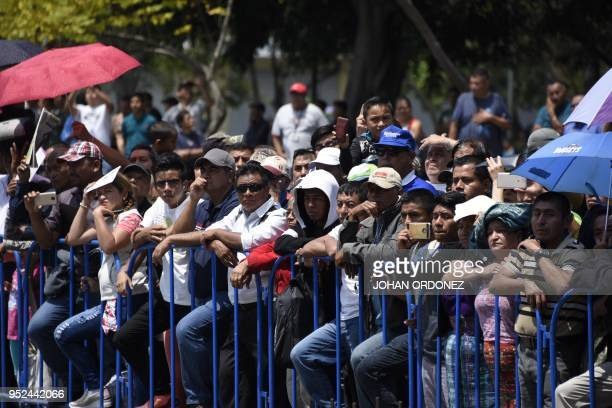 Guatemalans attend to the funeral of former Guatemalan President and Guatemala City Mayor, Alvaro Arzu, at Culture Palace in Guatemala City on April...