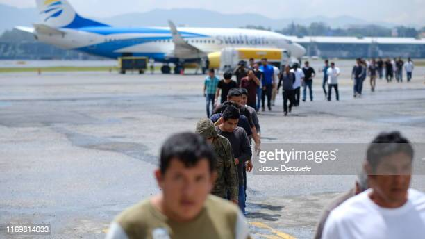 Guatemalans walk off a plane during the arrival of a flight coming from Mesa Arizona with deported Guatemalan Citizens at La Aurora International...