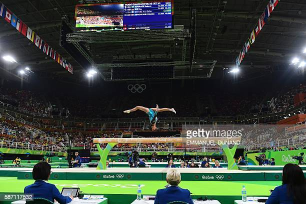 TOPSHOT Guatemala's Ana Sofia Gomez competes under the eyes of the jury members in the qualifying for the women's Beam event of the Artistic...
