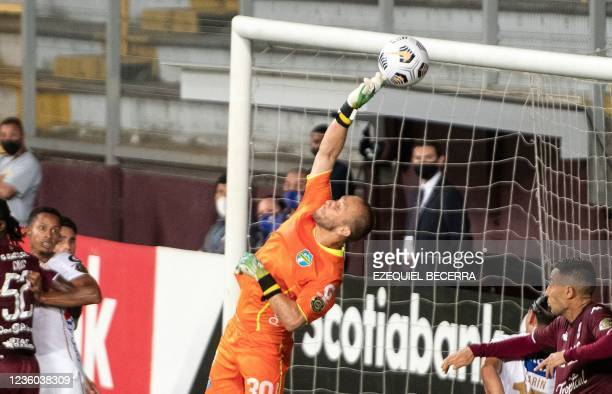 Guatemala's Comunicaciones goalkeeper Kevin Moscoso jumps to clear a ball during their Concacaf Champions league quarter-final first leg football...