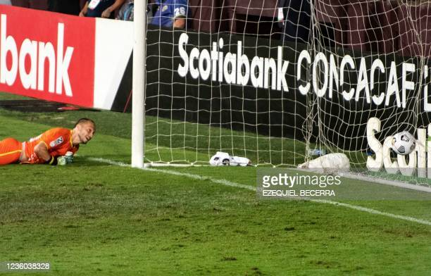 Guatemala's Comunicaciones goalkeeper Kevin Moscoso reacts after failing to stop a shot by Costa Rica's Saprissa during their Concacaf Champions...