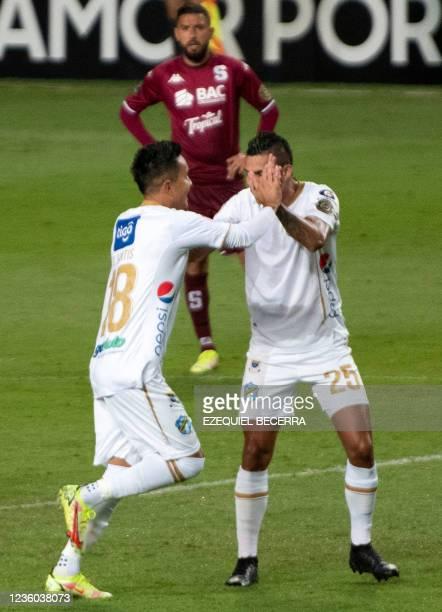 Guatemala's Comunicaciones Oscar Santis celebrates with Jorge Aparicio after scoring against Costa Rica's Saprissa during their Concacaf Champions...