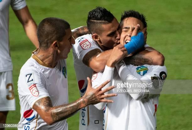 Guatemala's Comunicaciones Oscar Santis celebrates with Stephen Robles and Jorge Aparicio after scoring against Costa Rica's Saprissa during their...