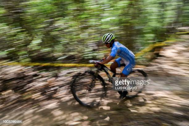 Guatemala's Florinda de Leon competes in the Women's Mountain Bike Cross Country finals event of the cyclying competition of the 2018 Central...