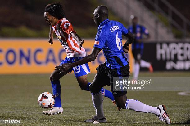 Guatemala's Heredia's Enrique Miranda vies for the ball with Canada's Montreal Hassoun during their Concacaf Champions League soccer match at...