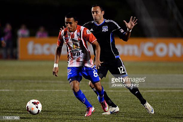 Guatemala's Heredia's Wilfred Velasquez vies for the ball with US Earthquakes Ramiro Corrales during their Concacaf Champions League soccer match at...
