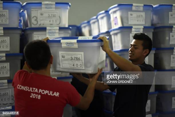 Guatemala's Supreme Electoral Court personnel prepare electoral material ahead of the upcoming April 15 referendum on the territorial difference with...