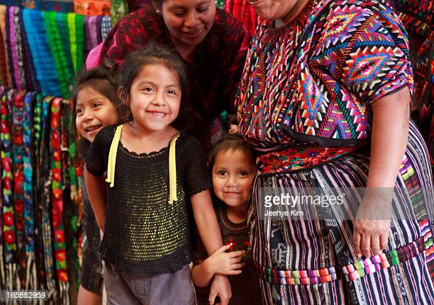 CONTENT] Guatemelan girls who live in community laugh and smile surrounded by colorful clothing and handcraft Chichicastenango Guatemala 2012