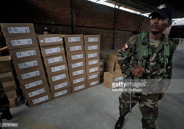 An Ecuadorean soldier guards electoral kits for Sunday's election at the Electoral Tribunal in Guayaquil 14 October 2006 Leftist US critic Rafael...
