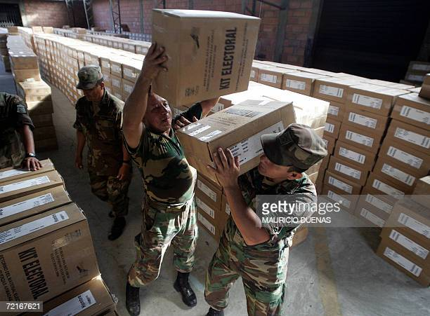 Ecuadorean soldiers carry electoral kits for Sunday's election at the Electoral Tribunal in Guayaquil 14 October 2006 Leftist US critic Rafael Correa...