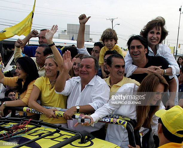 Presidential candidate Alvaro Noboa waves at his supporters on the campaigns' closing day 12 October in Guayaquil Guayas Province Ecuador According...