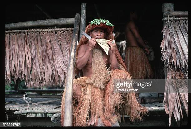 Guaymi Man in Grass Skirt Playing Panpipes