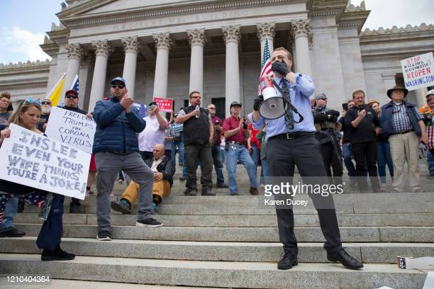 Gubernatorial candidate and anti-tax activist, Tim Eyman, speaks during a 'Hazardous Liberty! Defend the Constitution!' rally to protest the...