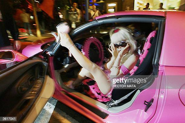 Gubernatorial candidate Angelyne the 'Hollywood Billboard Queen' arrives in her pink corvette to meet her supporters in a bar in West Hollywood 02...