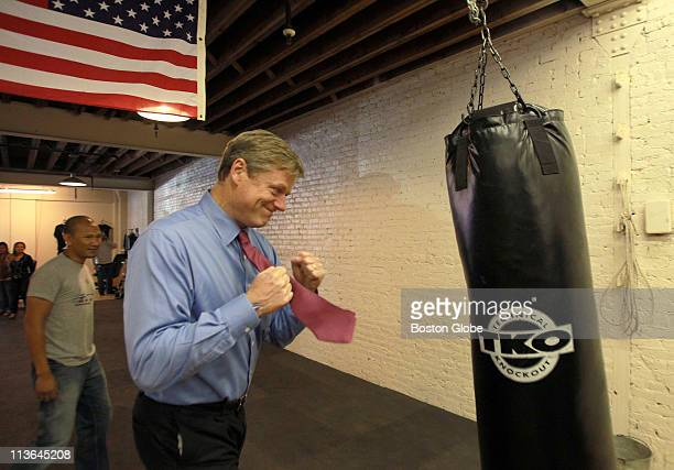 Gubernatorial candidate Charlie Baker delivered a flurry of punches to a punching bag as he visited the Kun Khmer Federation mixed martial arts gym...