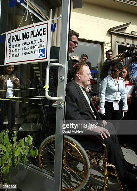 Gubernatorial candidate Larry Flynt, publisher of Hustler magazine, leaves after voting in the recall election of Gov. Gray Davis October 7, 2003 in...