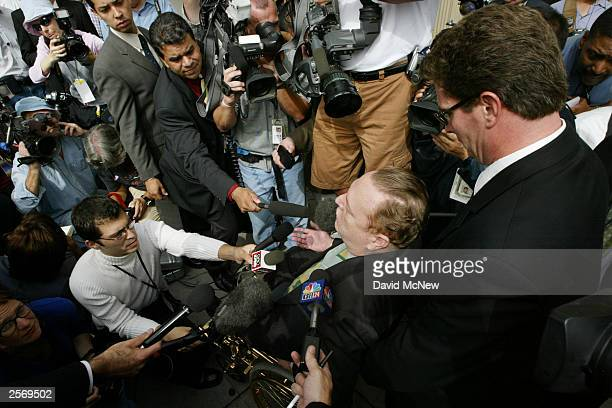 Gubernatorial candidate Larry Flynt, publisher of Hustler magazine, talks to the media as he arrives to vote in the recall election of Gov. Gray...