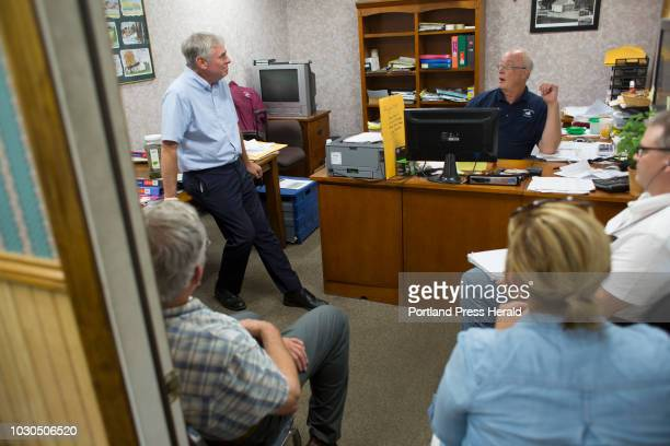 Gubernatorial candidate Shawn Moody left speaks with Robert Newcomb owner of Swan Lake Grocery while making a campaign visit to Swanville on August 3...