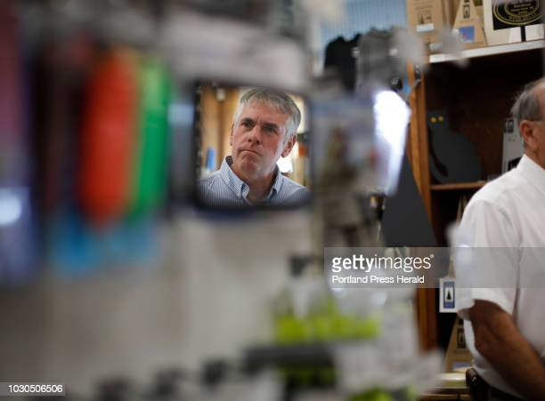 Gubernatorial candidate Shawn Moody listens to Wayne Hamilton owner of Hamilton Marine during a campaign stop in Searsport on August 3 2018