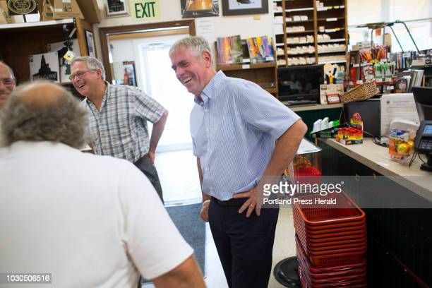 Gubernatorial candidate Shawn Moody right and Walter Whitcomb Commissioner of the Maine Department of Agriculture laugh as they share a moment with...
