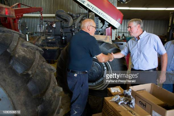 Gubernatorial candidate Shawn Moody shakes hands with Brad Brockway a mechanic at Ingraham Equipment during a campaign visit to Knox on August 3 2018