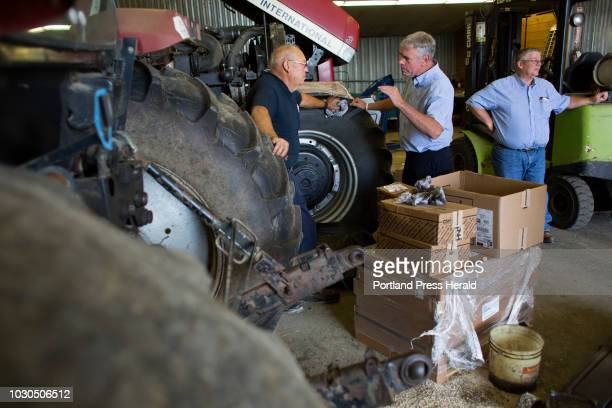 Gubernatorial candidate Shawn Moody shakes talks with Brad Brockway a mechanic at Ingraham Equipment during a campaign visit to Knox on August 3 2018