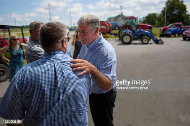 Gubernatorial candidate Shawn Moody shares a moment with Rodney Ingraham owner of Ingraham Equipment during a campaign stop in Knox on August 3 2018