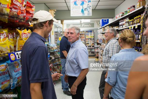 Gubernatorial candidate Shawn Moody talks with Michael Tribuzio an employee of Swan Lake Grocery while making a campaign visit to Swanville on August...