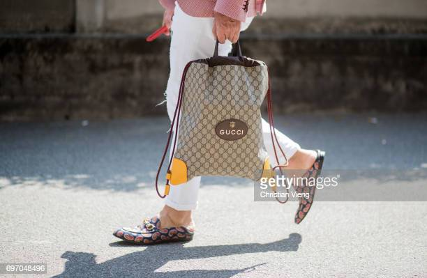 Gucci bag is seen outside Diesel during Milan Men's Fashion Week Spring/Summer 2018 on June 17 2017 in Milan Italy
