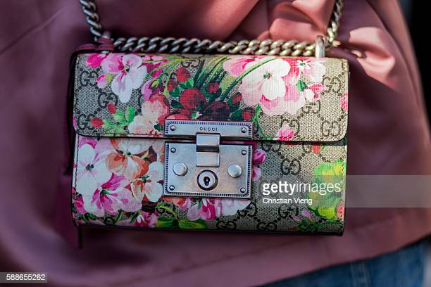 Gucci bag with floral print outside House of Dagmar during the second day of the Copenhagen Fashion Week Spring/Summer 2017 on August 11 2016 in...