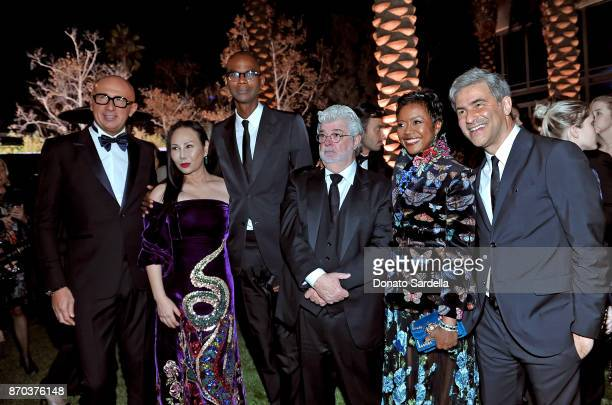 Gucci CEO Marco Bizzarri cohost Eva Chow wearing Gucci honoree Mark Bradford wearing Gucci honoree George Lucas Mellody Hobson and LACMA CEO and...