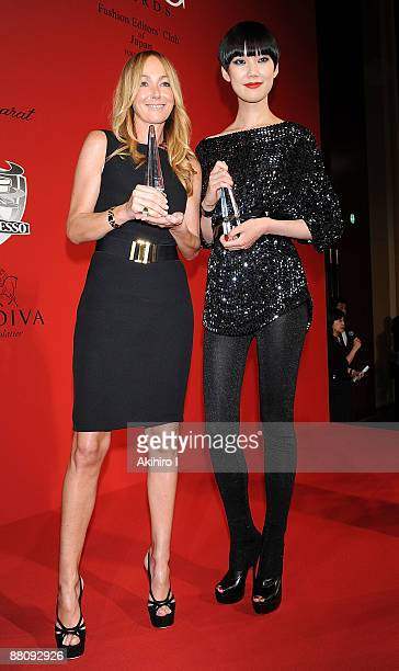 Gucci Creative Director Frida Giannini and model Tao pose during the 52nd FEC Awards at Conrad Tokyo on June 1 2009 in Tokyo Japan