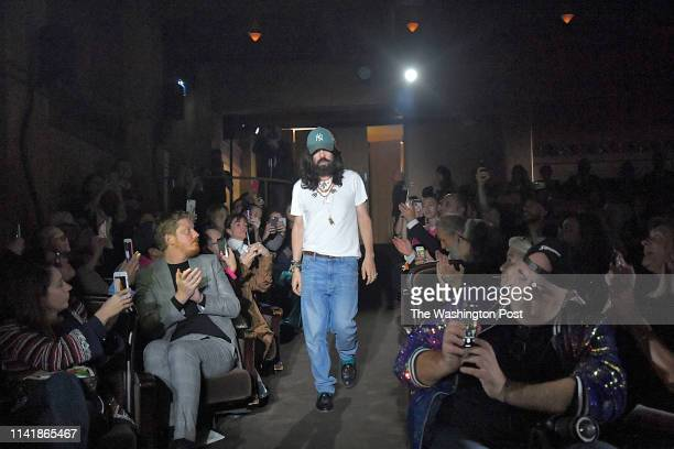 Gucci designer Alessandro Michele strides through the audience after presenting his spring / summer 2019 fashion show