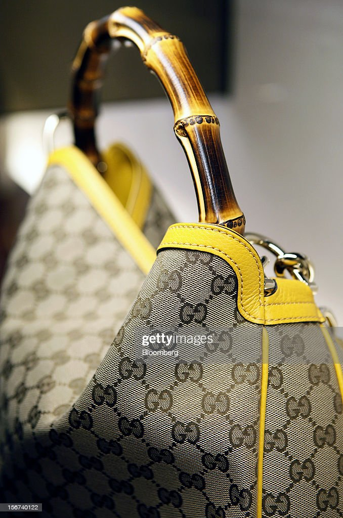 A Gucci 'Diana' bag sits on display inside a Gucci store, a luxury unit of France's PPR SA, in Rome, Italy, on Monday, Nov. 19, 2012. PPR SA, the French owner of the Gucci and Puma brands, said it's confident of revenue and profit growth in 2012. Photographer: Alessia Pierdomenico/Bloomberg via Getty Images