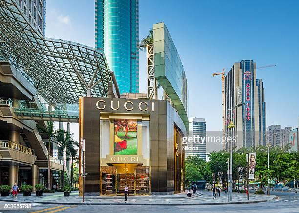 gucci flagship store in shenzhen, china - gucci beauty stock pictures, royalty-free photos & images