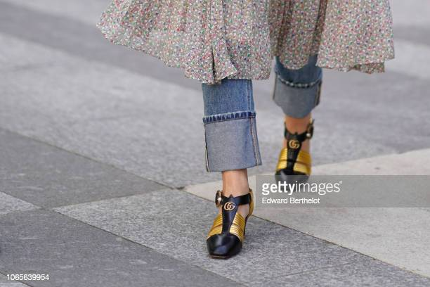Gucci golden and black shoes are seen outside Issey Miyake during Paris Fashion Week Menswear SpringSummer 2019 on June 21 2018 in Paris France