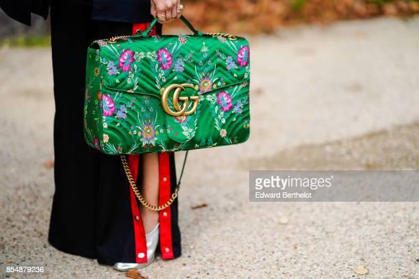 Gucci green bag is seen outside Margiela during Paris Fashion Week Womenswear Spring/Summer 2018 on September 27 2017 in Paris France
