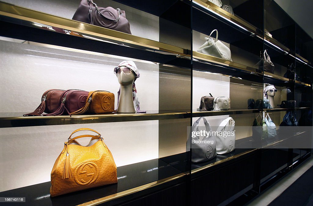 Gucci luxury bags bearing the interlocking 'G' logo sit displayed for sale inside a Gucci store, a luxury unit of France's PPR SA, in Rome, Italy, on Monday, Nov. 19, 2012. PPR SA, the French owner of the Gucci and Puma brands, said it's confident of revenue and profit growth in 2012. Photographer: Alessia Pierdomenico/Bloomberg via Getty Images