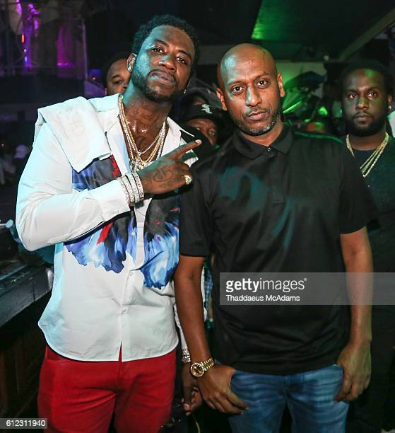 Gucci Mane and Alex Giewon at Cafe Iguana Pines on October 3 2016 in Pembroke Pines Florida