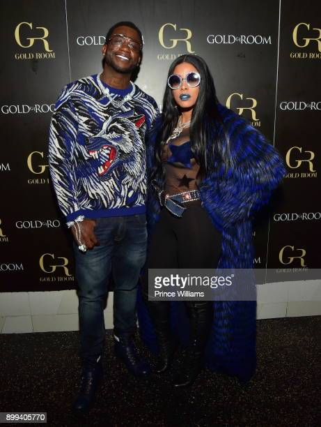 Gucci Mane and Keyshia Ka'oir attend the Gucci Mane El Gato The Human Glacier album release party at Gold Room on December 22 2017 in Atlanta Georgia