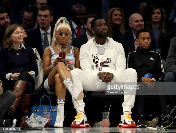Gucci Mane and Keyshia Ka'Oir watch the action during the NBA AllStar game as part of the 2019 NBA AllStar Weekend at Spectrum Center on February 17...