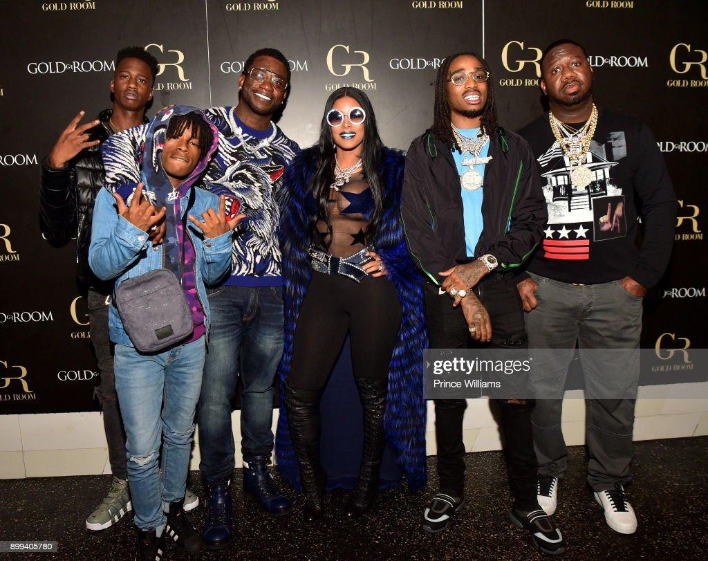 Gucci Mane, Keyshia Ka'oir, Quavo and Pierre 'Pee' Thomas attend the Gucci Mane 'El Gato The Human Glacier' album release party at Gold Room on December 22, 2017 in Atlanta, Georgia.