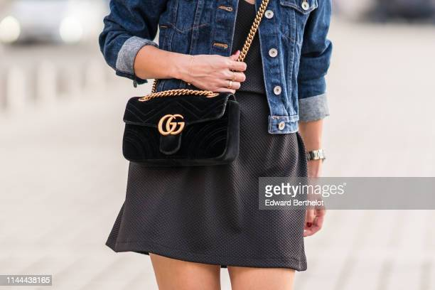 Gucci Marmont bag a black dress a blue denim jacket are seen on April 22 2019 in Paris France