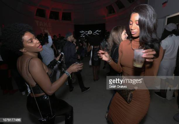 Gucci sales associate Joana Marquez dances with Sotheby's real estate advisor Jazzma Kendrick at the Bacardi No Commission Marquee Performance hosted...