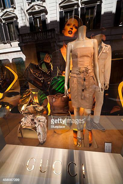 gucci, shop window in rome, italy. - gucci dress stock pictures, royalty-free photos & images