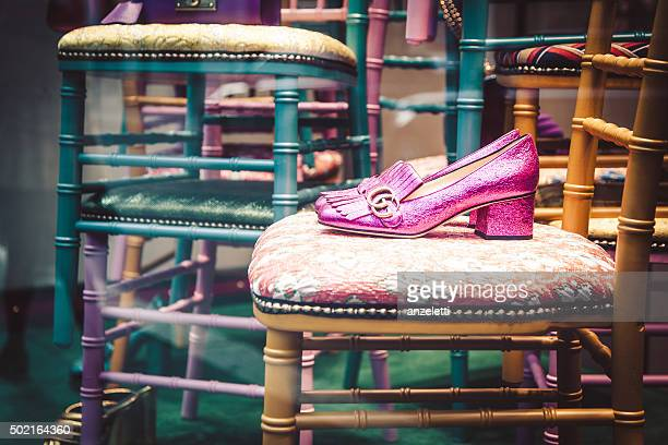 gucci shop window in via napoleone - gucci shoe stock pictures, royalty-free photos & images